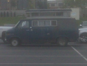 Bad phone pic, but you can see the camper shell dropped into the roof of this van. It's just marvelous! I love all the rust and dents on the body. The owner looks like he has a few dents of his own, but he's still standing. If I ever see him again, I will tell him that his van is a star in a story I'm revising.