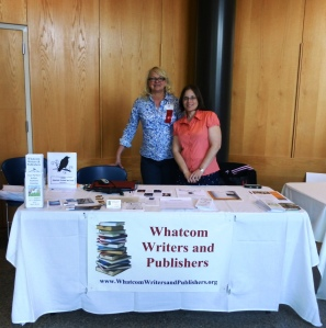 Kiffer Brown of Chanticleer Reviews and Amanda June Hagarty staff the Whatcom Writers and Publishers table