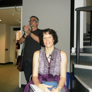 Panel Host and former Conference Organizer Nan Macy (with a slightly known writer seen in the background).