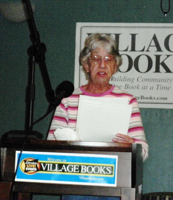 "Sylvia Crosby reading her tale about a man who misses his wives and finds his son ""slimy."""